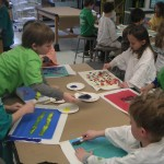 Kindergarten students creating tissue paper just like Eric Carle.